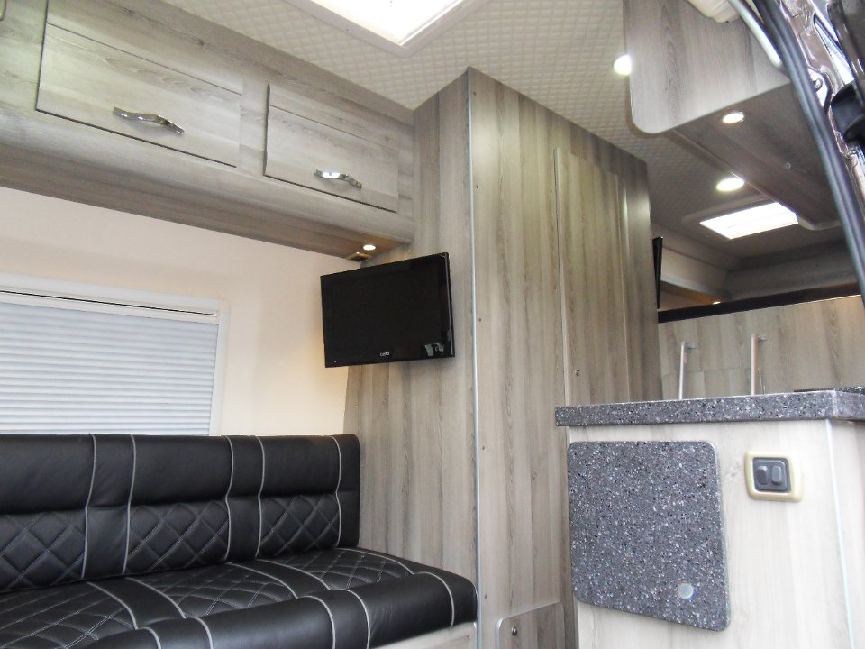 L Shape Lounge Finished In Black And Grey Leather Diamond Stitched Upholstery 2 X TVs Microwave Burner Hob With Combined Sink